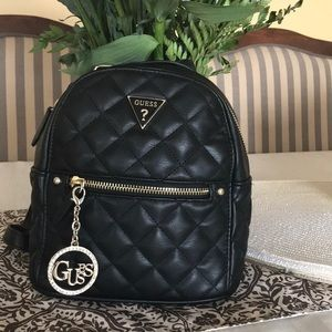 Mini cossbody and classic Guess backpack
